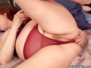 chubby granny probes her elderly pussy with a