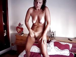 girl having an intense standing orgasm
