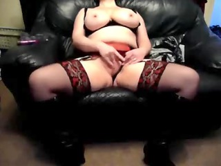 naughty wife on a leather sofa at home
