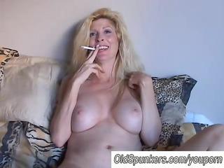 beautiful blonde lady likes a smoke break