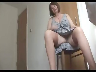busty, bushy older  plump is getting nude and