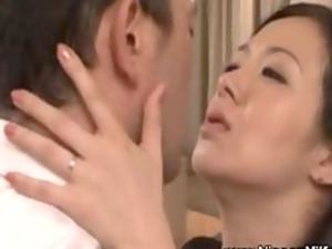 cougar asian woman kissing with voyeur