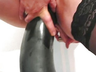 frustrated woman fucking gigantic dildos