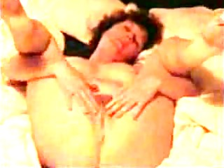 mature housewife plays on the bedstead