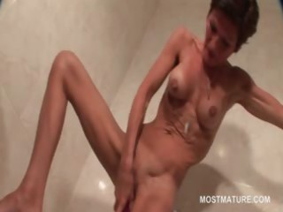 slim cougar chick copulates her cave with sex toy