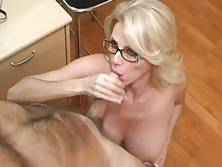 mature assistant obtains white cream on her big