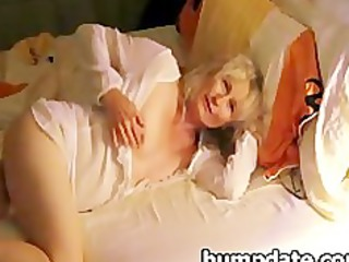 bleached older  pushing dildo for her man