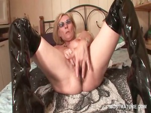 older into latex galoshes dildoing vagina with