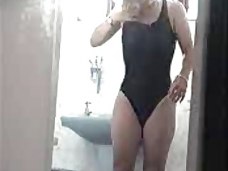 voyeur older changing out of swimsuit