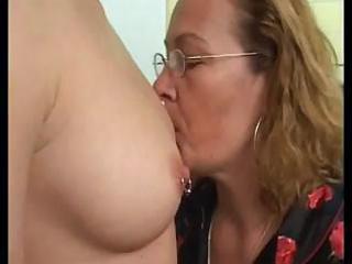 cougar homosexual woman teaching a fresh dike how
