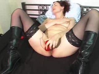 grownup masturbating with a yellow sex toy