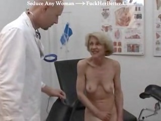 elderly gets her injection at the doctors
